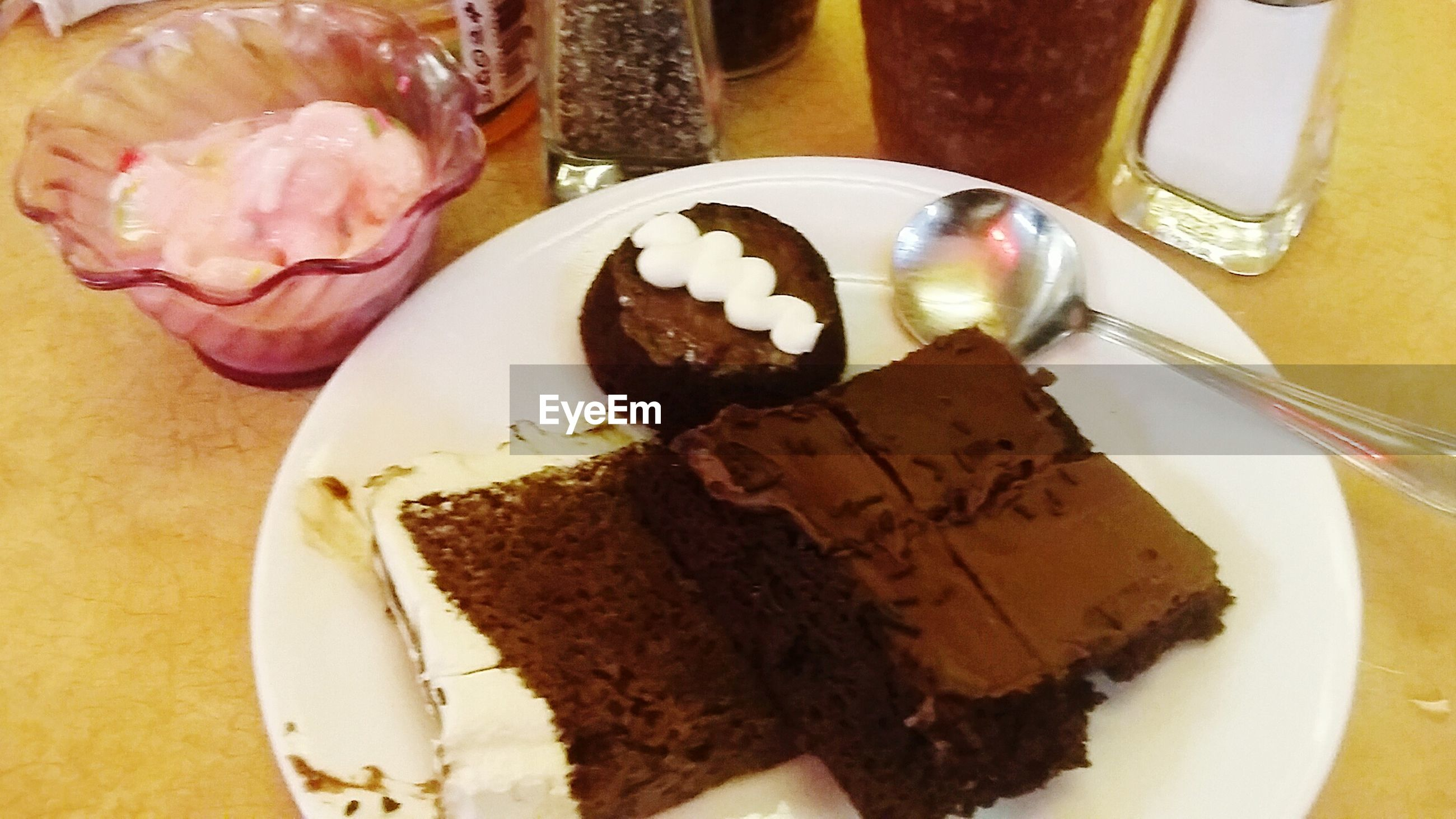 food and drink, food, freshness, sweet food, ready-to-eat, indoors, dessert, plate, indulgence, unhealthy eating, still life, table, cake, serving size, breakfast, high angle view, close-up, temptation, chocolate, bread
