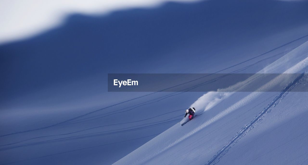 Low Angle View Of Man Skiing Against Sky