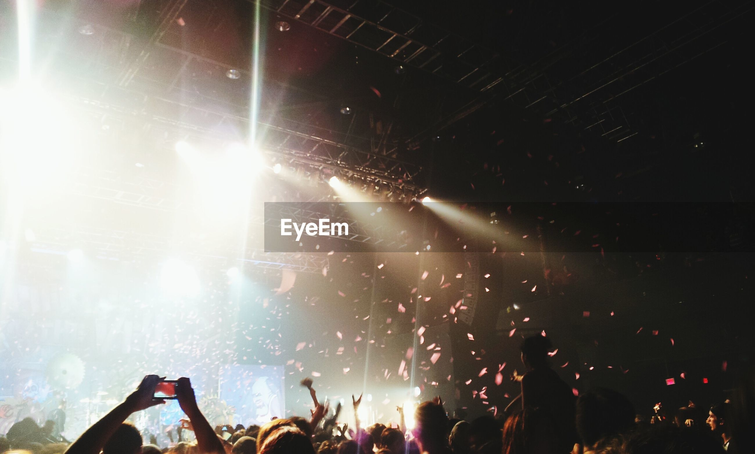 arts culture and entertainment, large group of people, event, lifestyles, illuminated, enjoyment, leisure activity, men, music, night, crowd, performance, music festival, nightlife, fun, popular music concert, stage - performance space, person, excitement