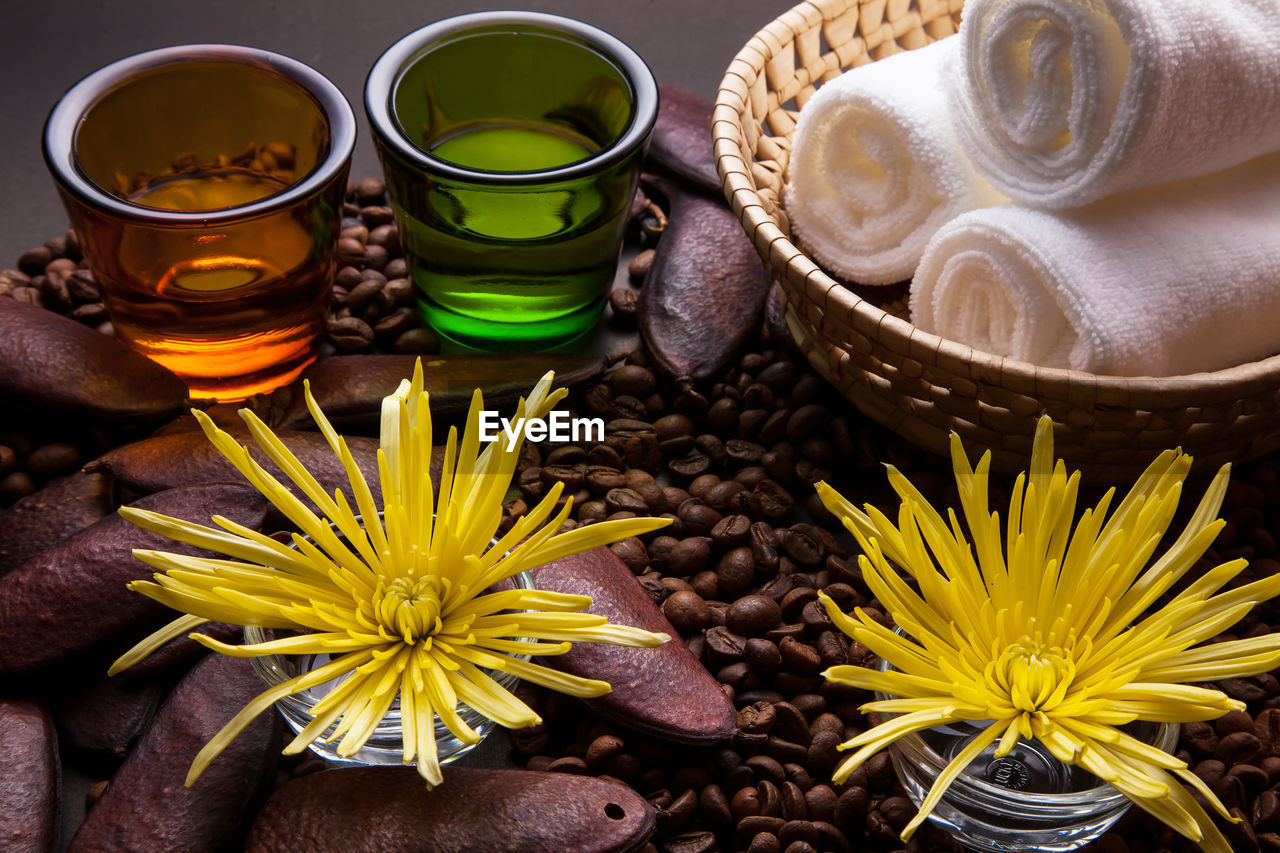 High angle view of flowers in container and coffee beans on table