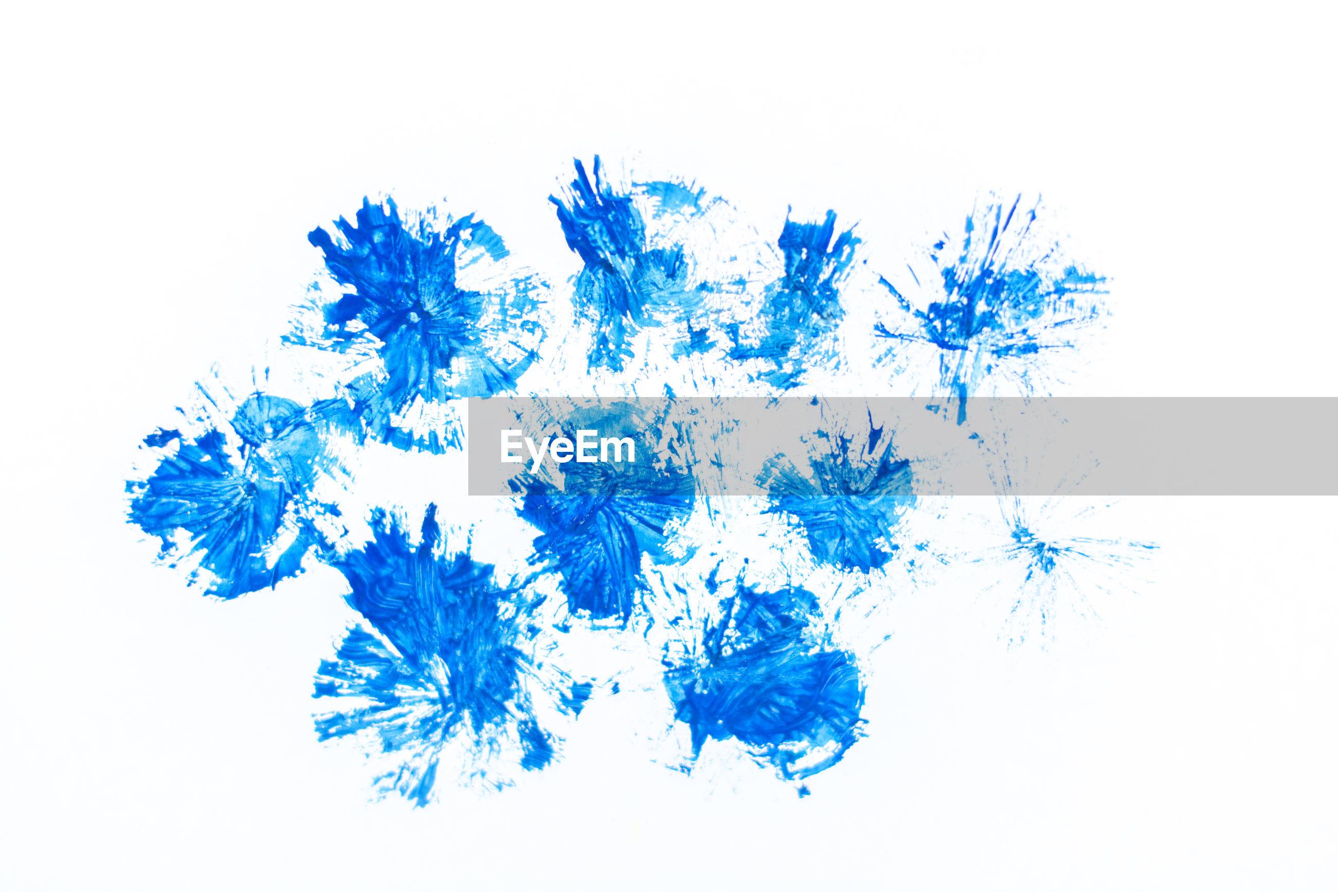 Blue paint on paper