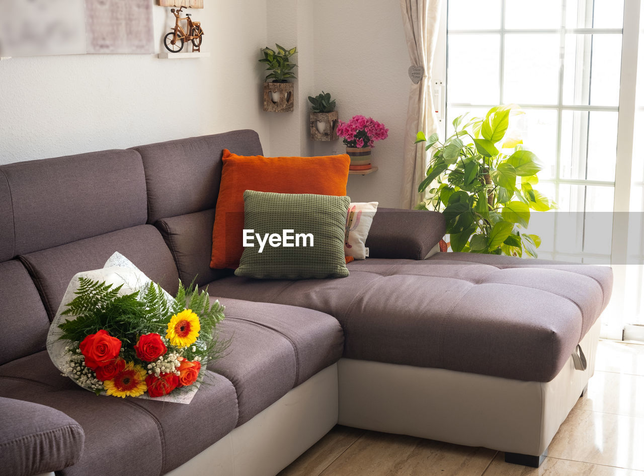 Flower bouquet on sofa at home