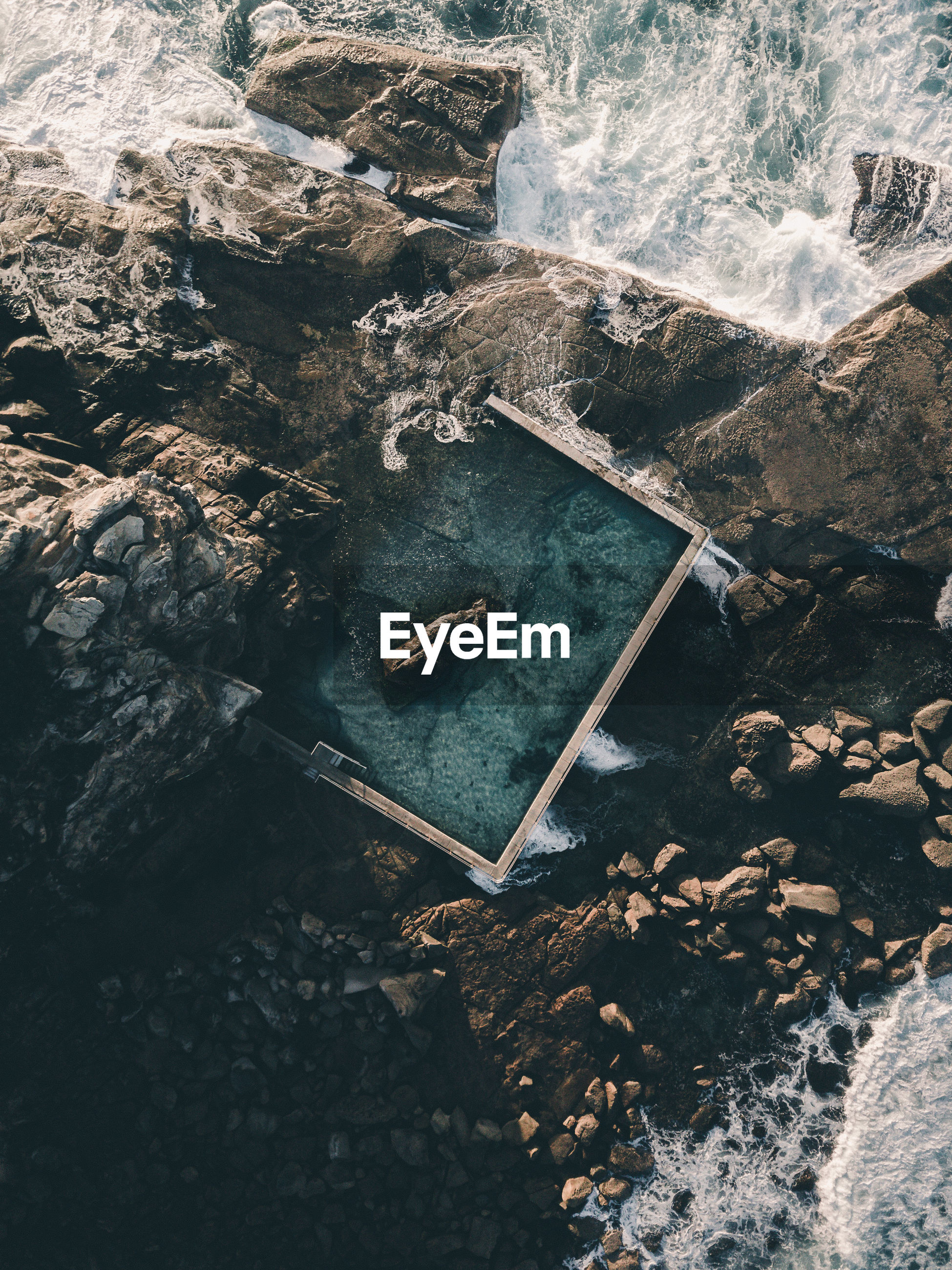 High angle view of swimming pool by rocks