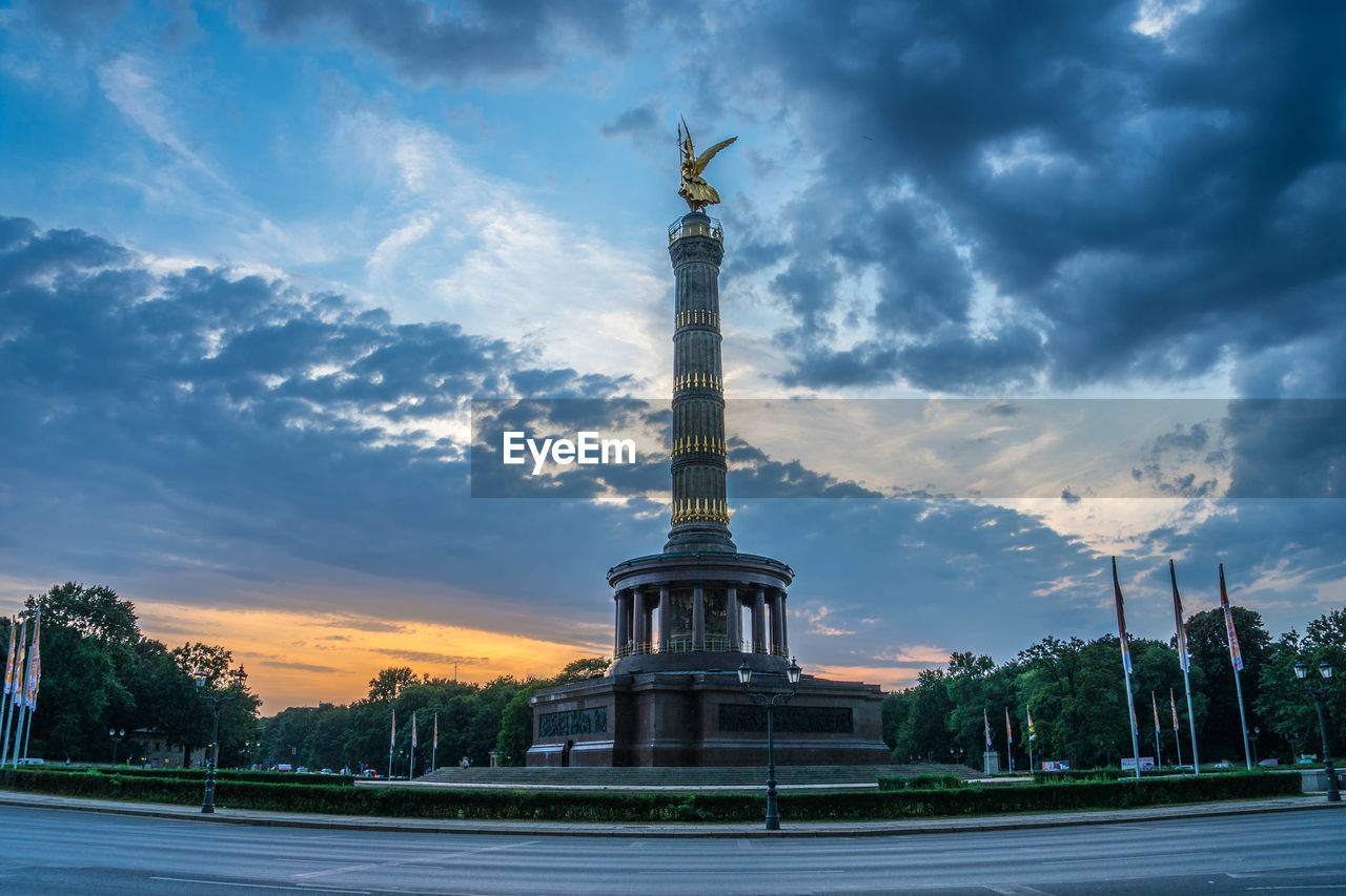 cloud - sky, sky, architecture, built structure, building exterior, travel destinations, memorial, history, nature, sculpture, the past, monument, city, architectural column, travel, no people, human representation, sunset, statue, tall - high, outdoors