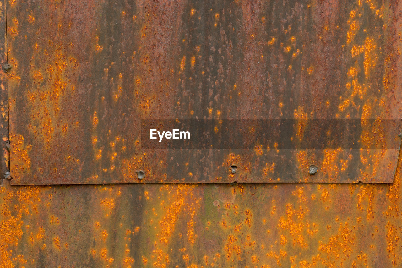 textured, weathered, close-up, rusty, backgrounds, full frame, pattern, day, no people, wood - material, hinge, outdoors, yellow, architecture, corrugated iron