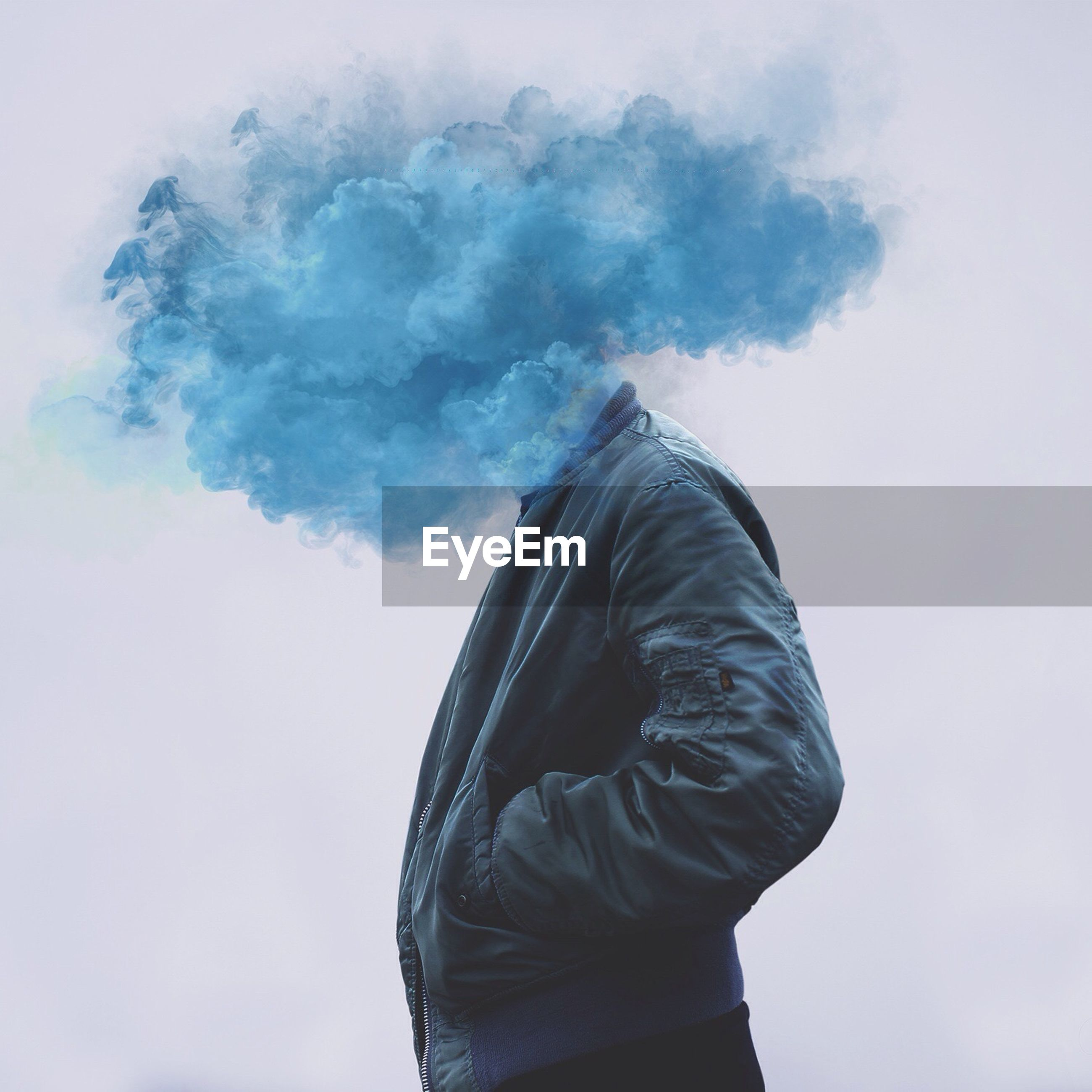 Digital composite image of smoke exploding on man face