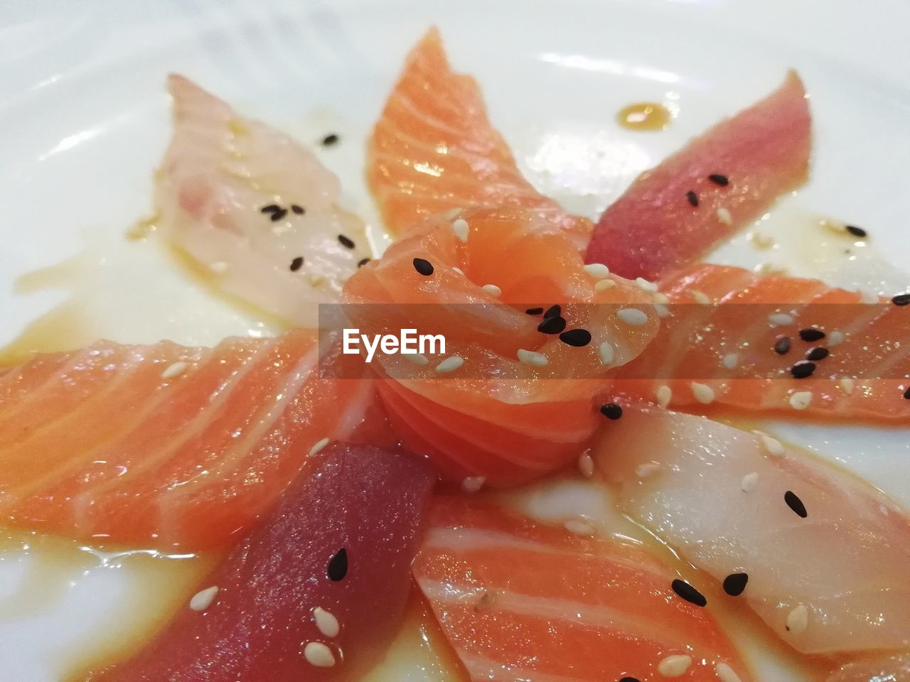 food, food and drink, plate, healthy eating, close-up, freshness, still life, indoors, ready-to-eat, wellbeing, seafood, serving size, fish, no people, salmon - seafood, asian food, animal, japanese food, fruit, indulgence, caviar, temptation