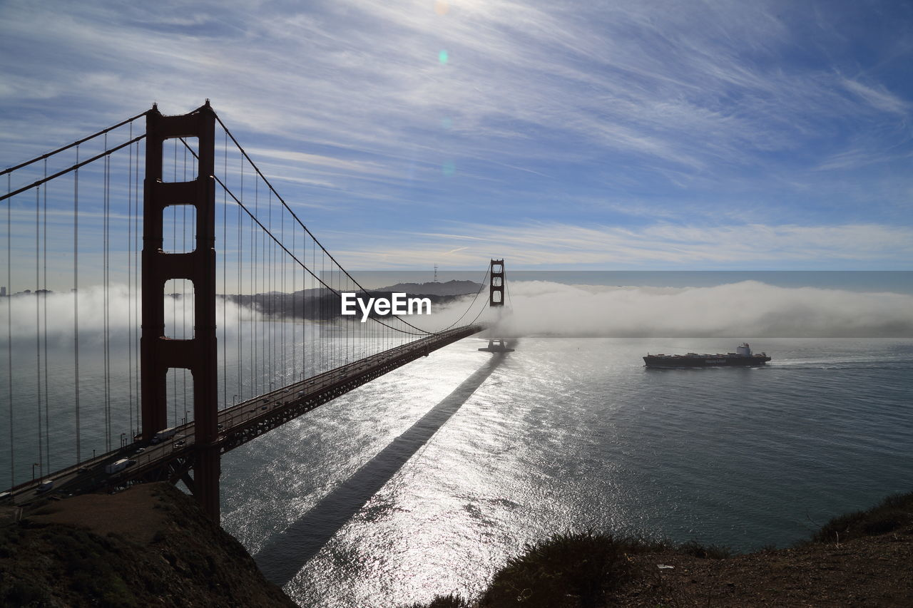 water, sky, bridge, connection, bridge - man made structure, cloud - sky, built structure, sea, suspension bridge, architecture, nature, transportation, travel destinations, day, beauty in nature, engineering, bay of water, tourism, bay, outdoors