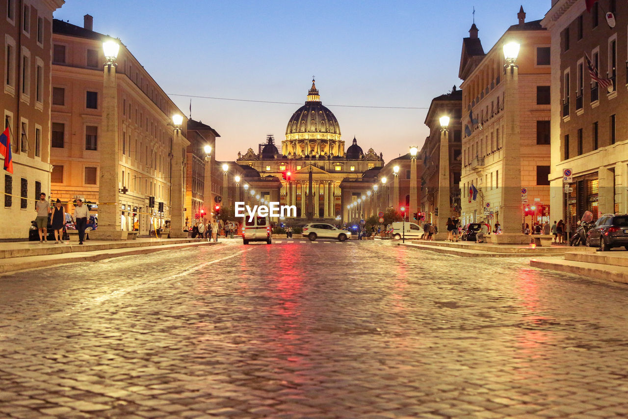 Illuminated Street Leading Towards St Peter Basilica Church During Sunset