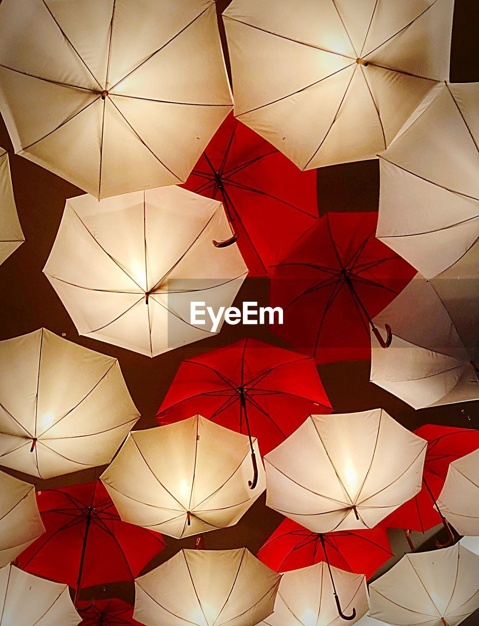 umbrella, full frame, pattern, backgrounds, no people, protection, large group of objects, hanging, design, low angle view, decoration, red, shape, creativity, security, art and craft, choice, indoors, still life, ceiling, directly below