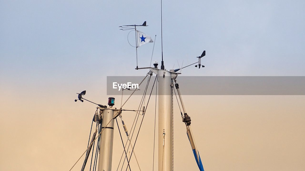 Low Angle View Of Mast Against Clear Sky During Sunset
