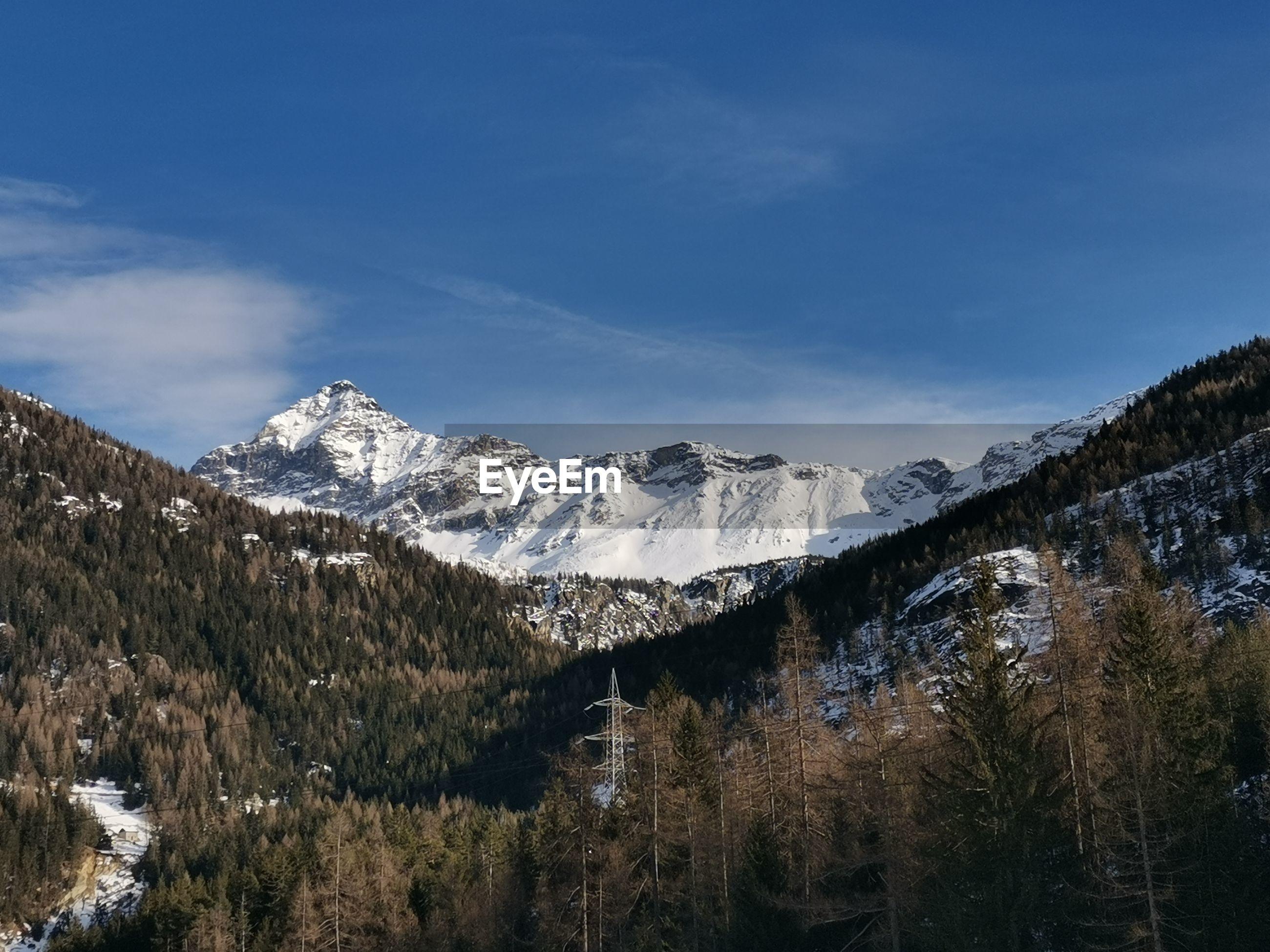 Scenic view of snowcapped mountains against sky