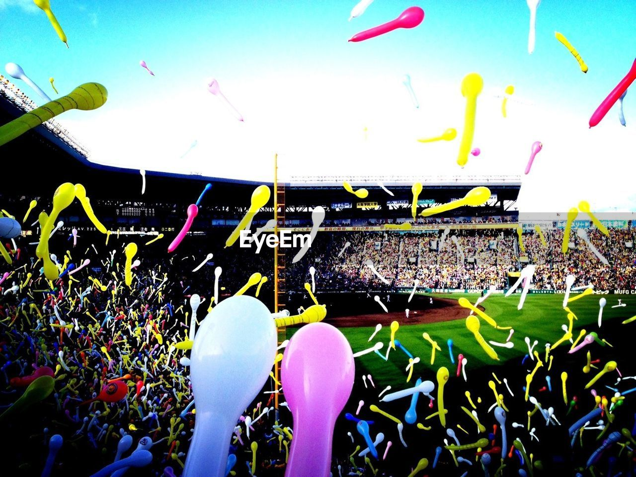 crowd, large group of people, audience, spectator, stadium, excitement, sport, event, cheering, togetherness, enjoyment, real people, fan - enthusiast, confetti, celebration, soccer, outdoors, day, men, flying, human hand, people