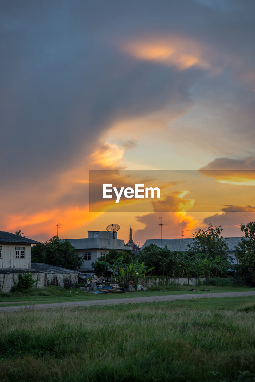 sunset, sky, cloud - sky, built structure, architecture, orange color, building exterior, plant, nature, factory, grass, beauty in nature, field, industry, land, environment, scenics - nature, no people, outdoors, growth