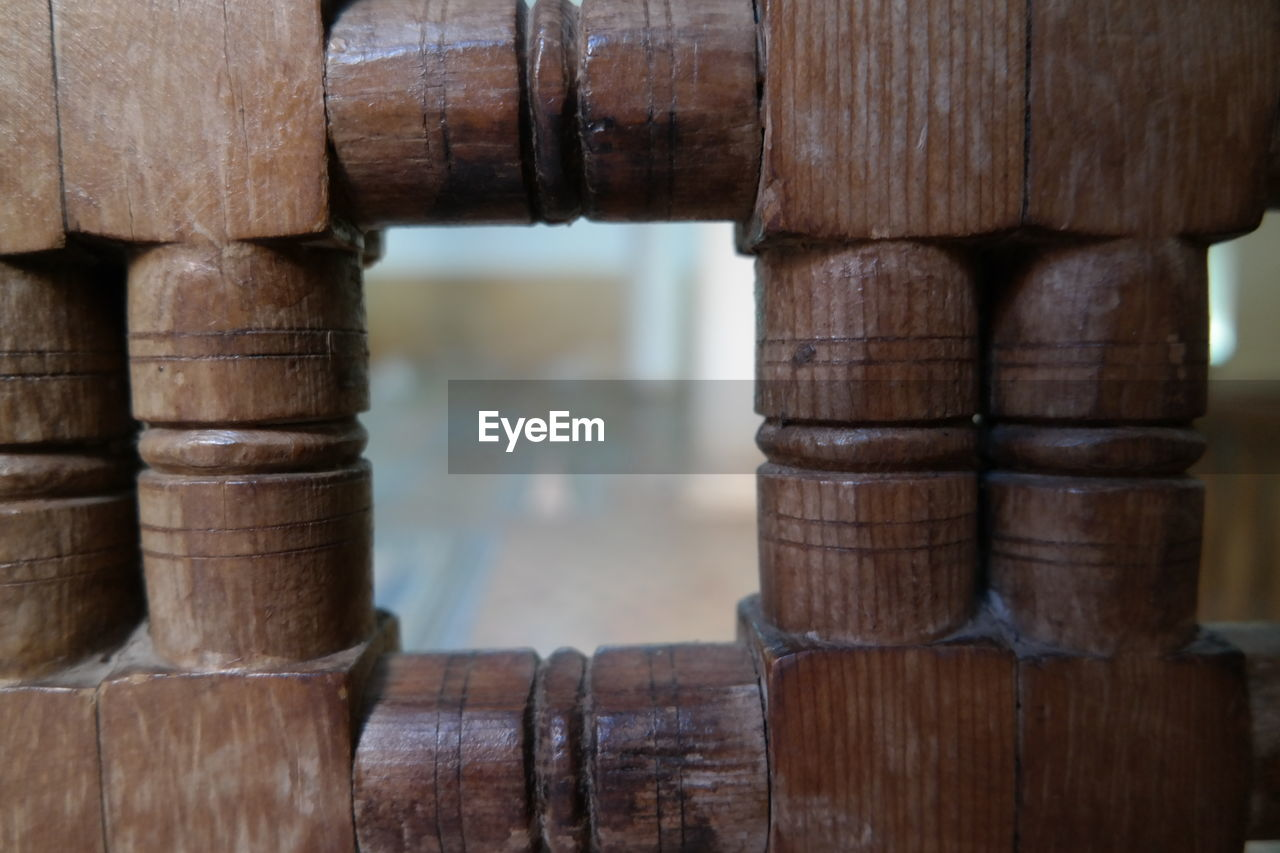 wood - material, focus on foreground, no people, close-up, indoors, day, brown, selective focus, stack, architecture, large group of objects, pattern, still life, water, bamboo - material, textured, shape, built structure, food and drink