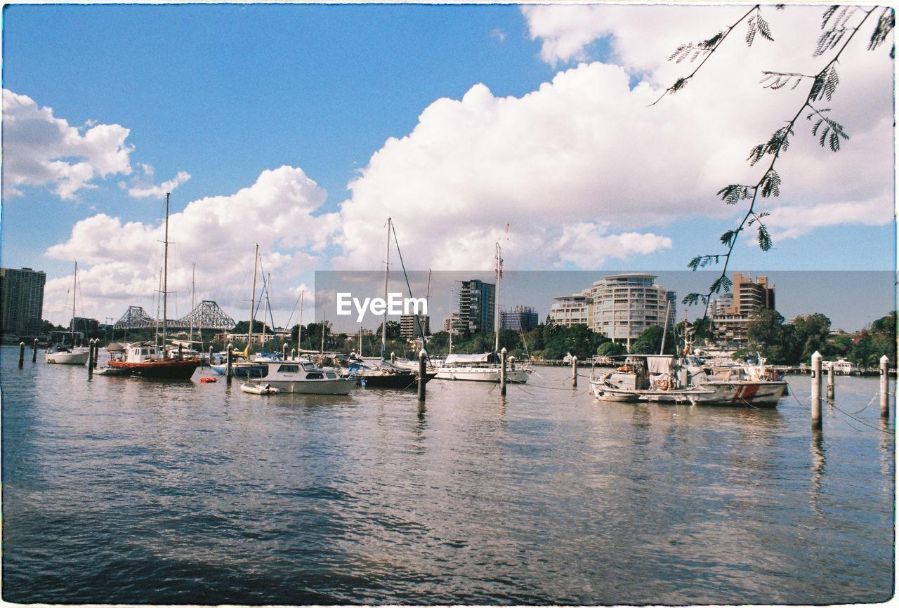 nautical vessel, cloud - sky, water, transportation, sky, building exterior, built structure, architecture, waterfront, mode of transportation, moored, nature, city, day, no people, sea, building, harbor, travel, outdoors, sailboat, yacht, marina, anchored, port, bay