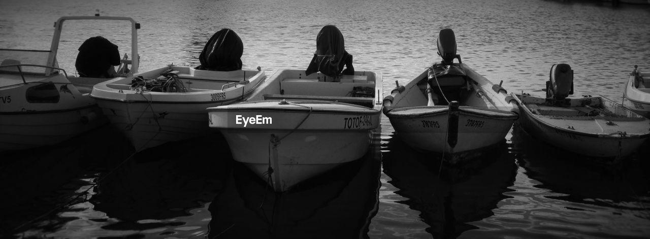 water, nautical vessel, outdoors, moored, day, lake, transportation, nature, men, women, people