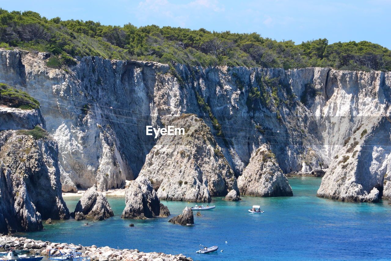 water, rock, sea, nature, scenics - nature, beauty in nature, waterfront, no people, day, environment, mountain, rock - object, solid, tranquil scene, tranquility, land, outdoors, cliff, formation, turquoise colored, eroded
