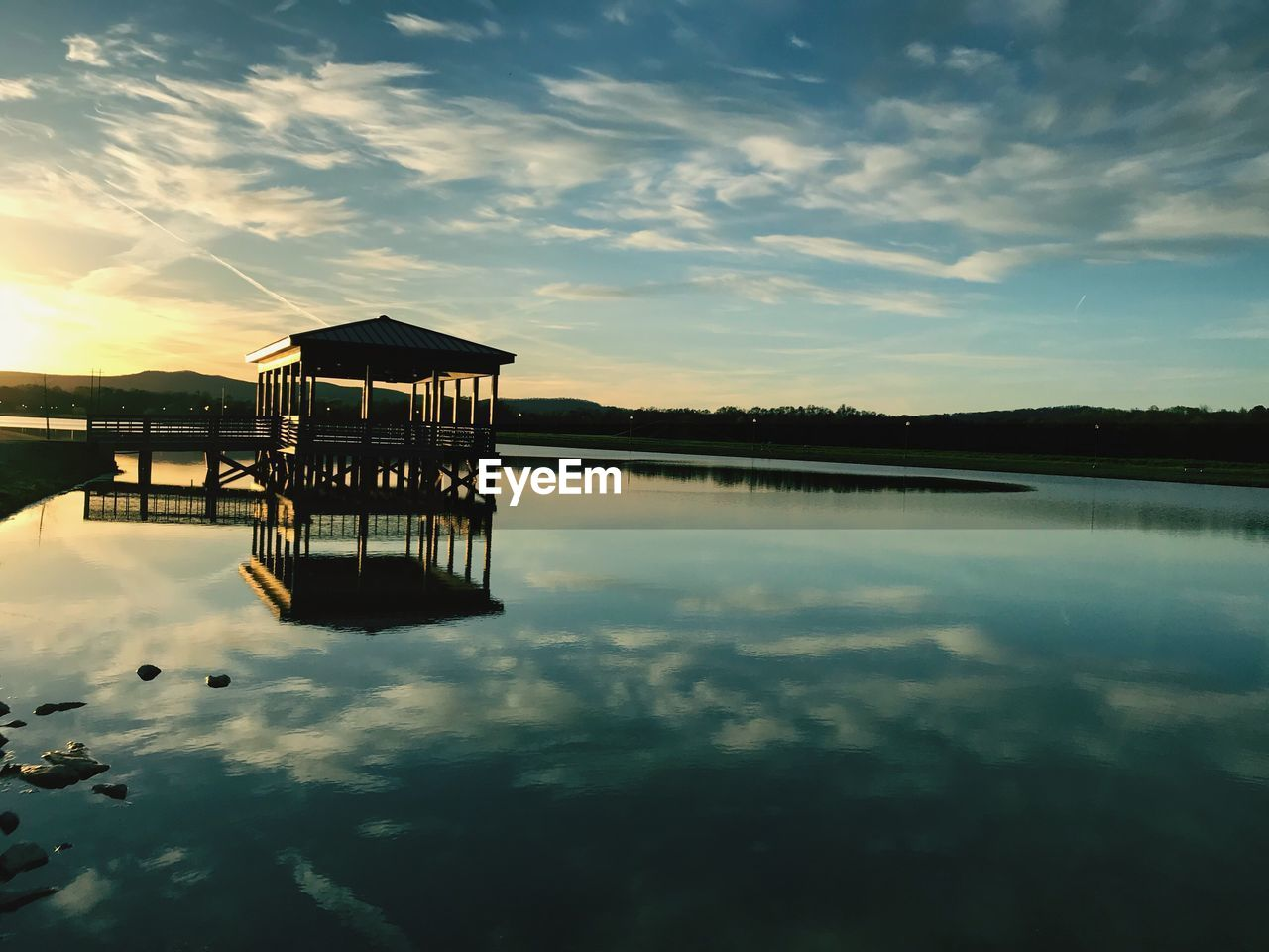 water, sky, reflection, cloud - sky, tranquility, waterfront, lake, tranquil scene, scenics - nature, beauty in nature, architecture, built structure, sunset, nature, no people, standing water, stilt house, silhouette, outdoors