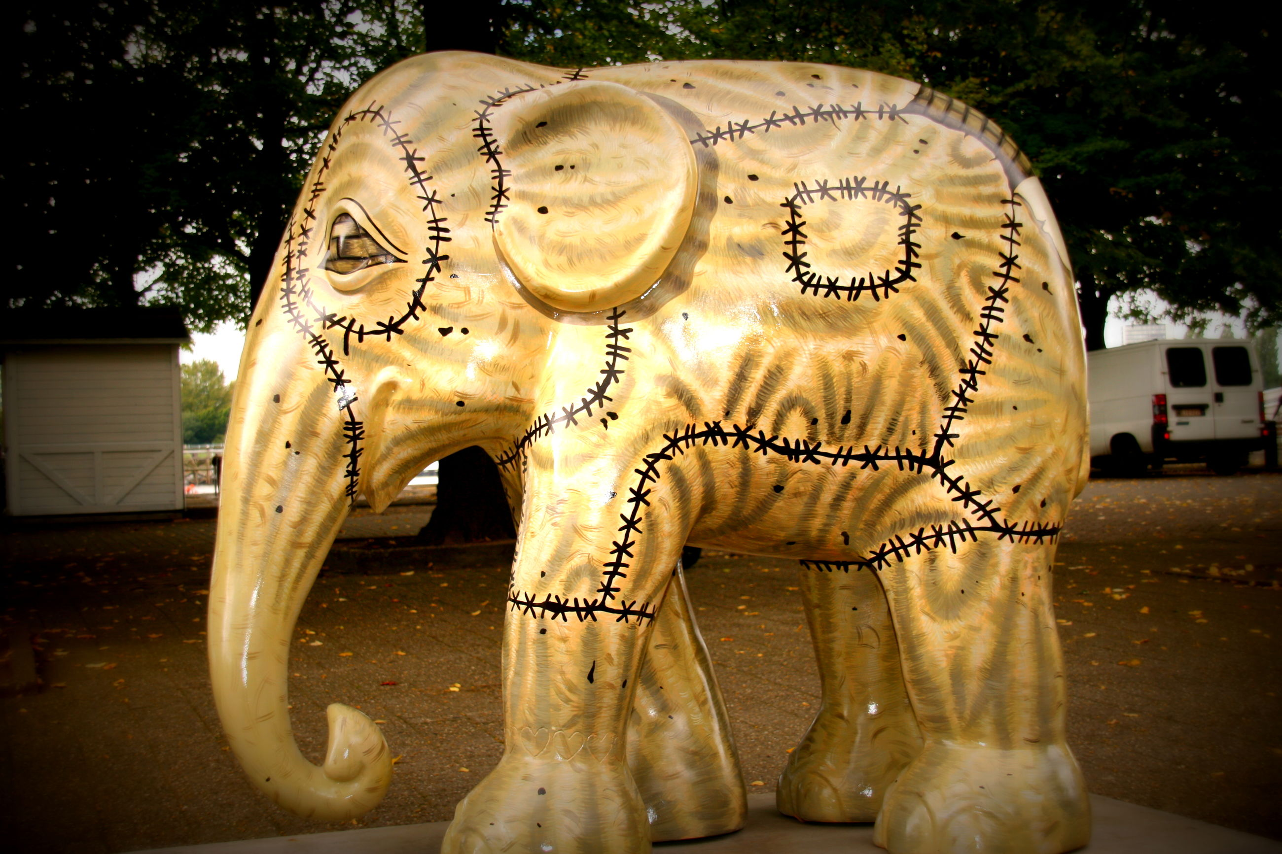 art and craft, art, creativity, text, close-up, human representation, circle, animal representation, indoors, no people, western script, day, sculpture, carving - craft product, communication, tree, shape