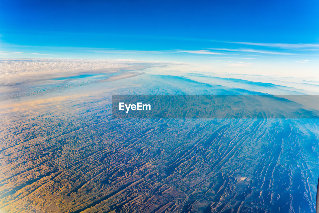 scenics - nature, beauty in nature, sky, blue, aerial view, cloud - sky, nature, no people, environment, tranquility, landscape, tranquil scene, day, idyllic, land, outdoors, non-urban scene, water, physical geography, airplane