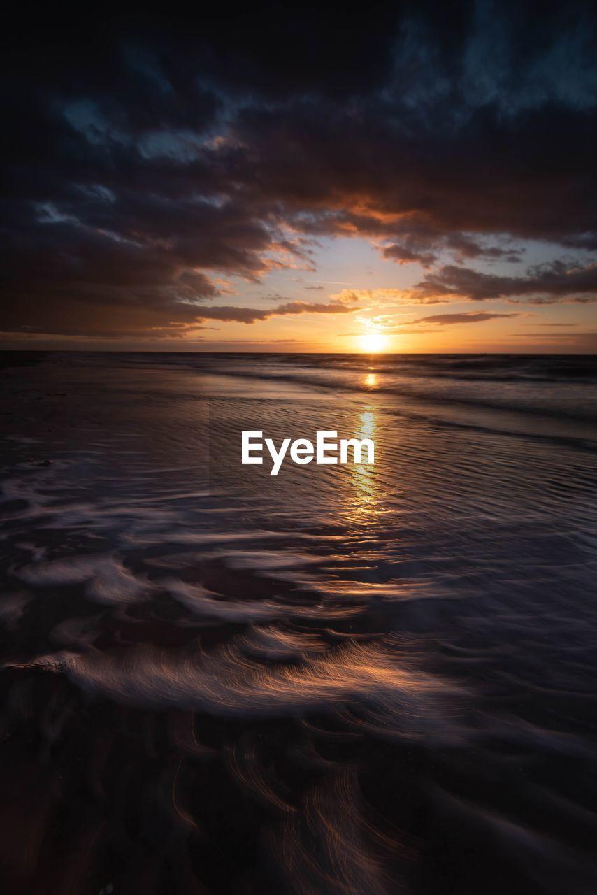 sunset, sky, water, beauty in nature, scenics - nature, cloud - sky, tranquility, sea, tranquil scene, horizon over water, idyllic, horizon, reflection, no people, nature, beach, orange color, land, non-urban scene, sun, outdoors