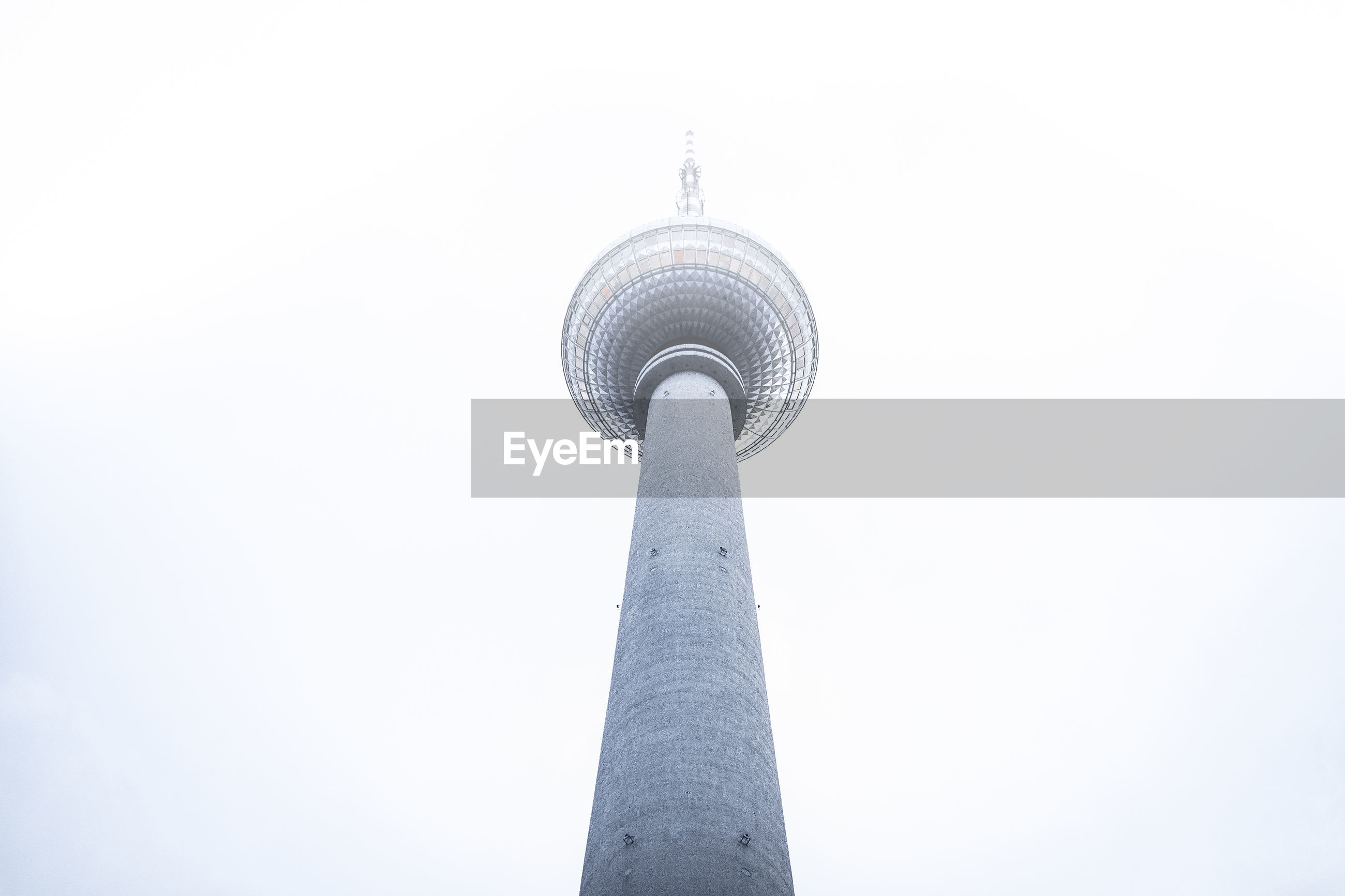 LOW ANGLE VIEW OF COMMUNICATIONS TOWER IN CITY