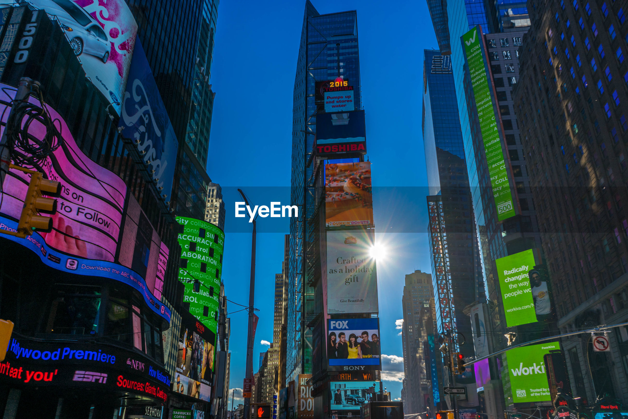 Low angle view of illuminated billboards on buildings at times square