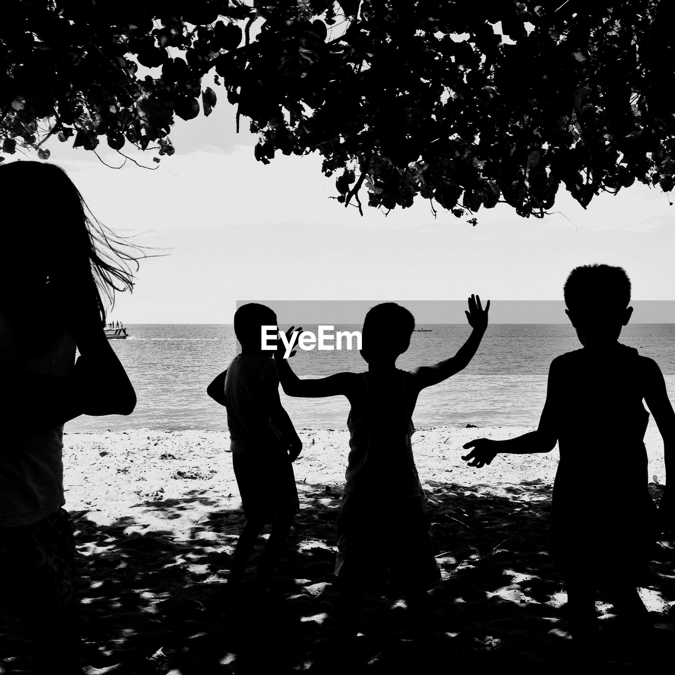 Silhouette of children on beach