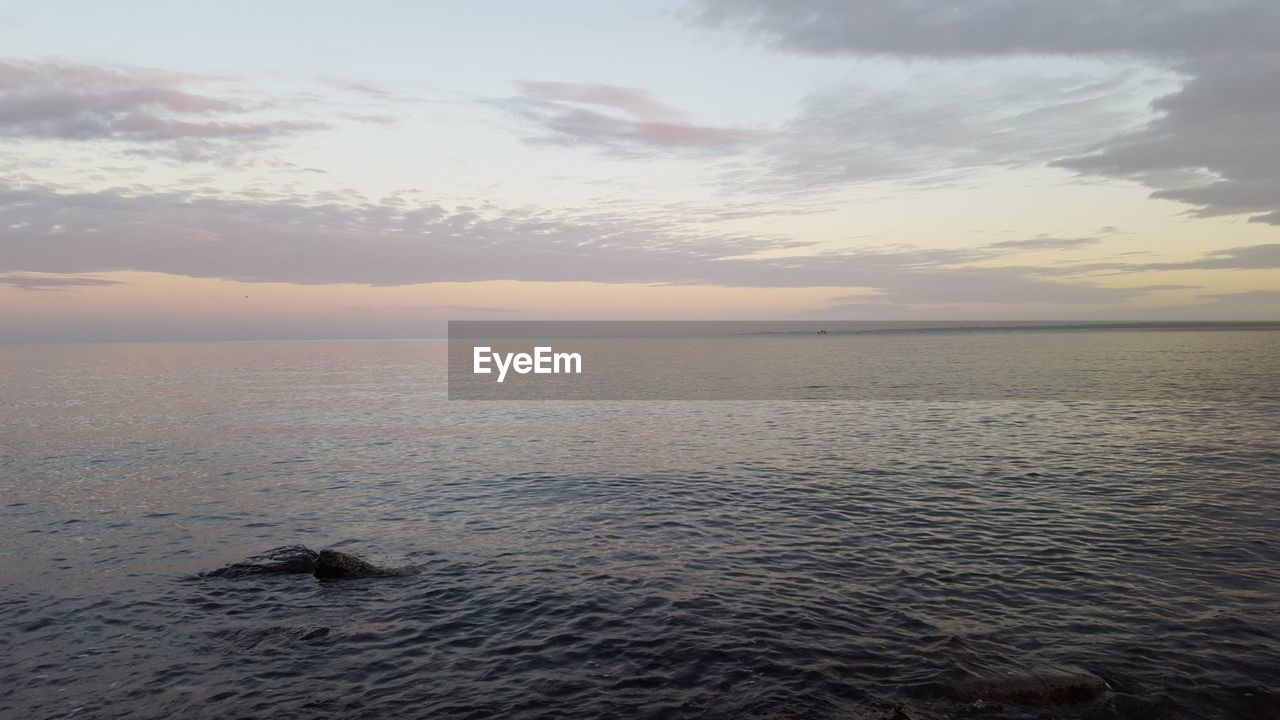 scenics, sea, tranquility, beauty in nature, tranquil scene, nature, water, sunset, sky, idyllic, no people, cloud - sky, horizon over water, outdoors, beach, day
