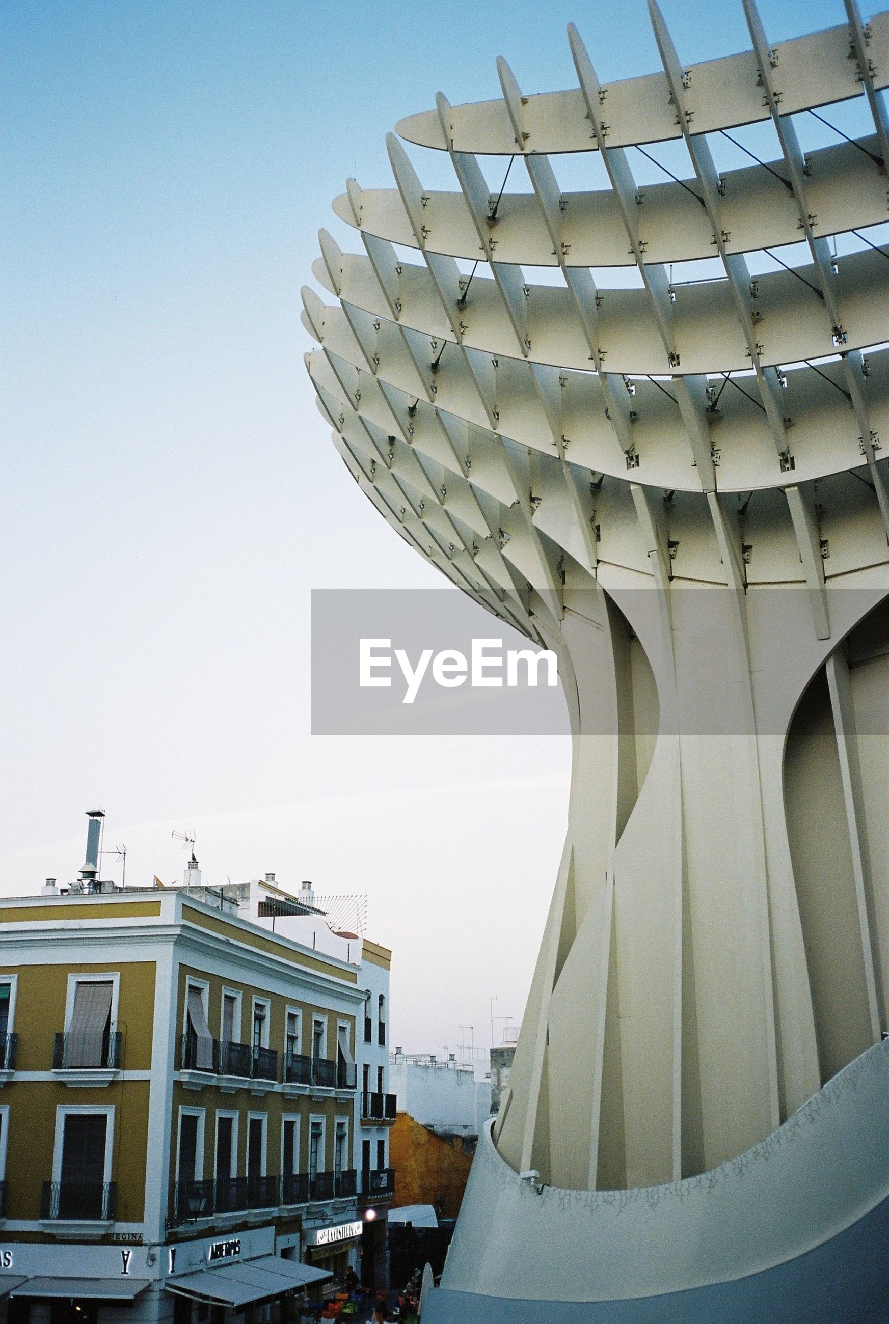 architecture, built structure, building exterior, clear sky, low angle view, famous place, travel destinations, international landmark, travel, tourism, capital cities, city, history, architectural feature, day, incidental people, building, arch, sunlight, architectural column