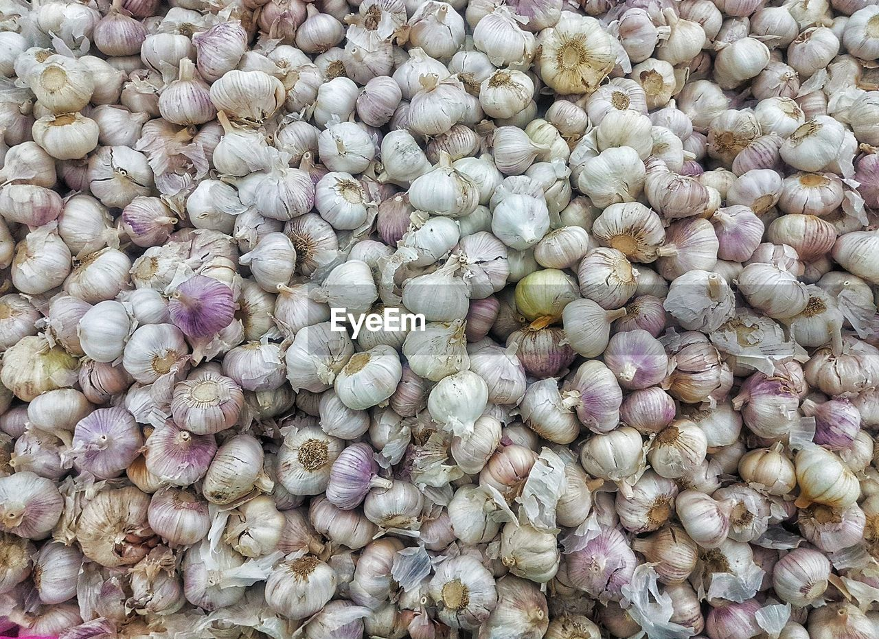 food and drink, food, full frame, wellbeing, large group of objects, backgrounds, freshness, healthy eating, abundance, no people, still life, vegetable, onion, market, high angle view, for sale, day, close-up, ingredient, garlic, purple, vegetarian food