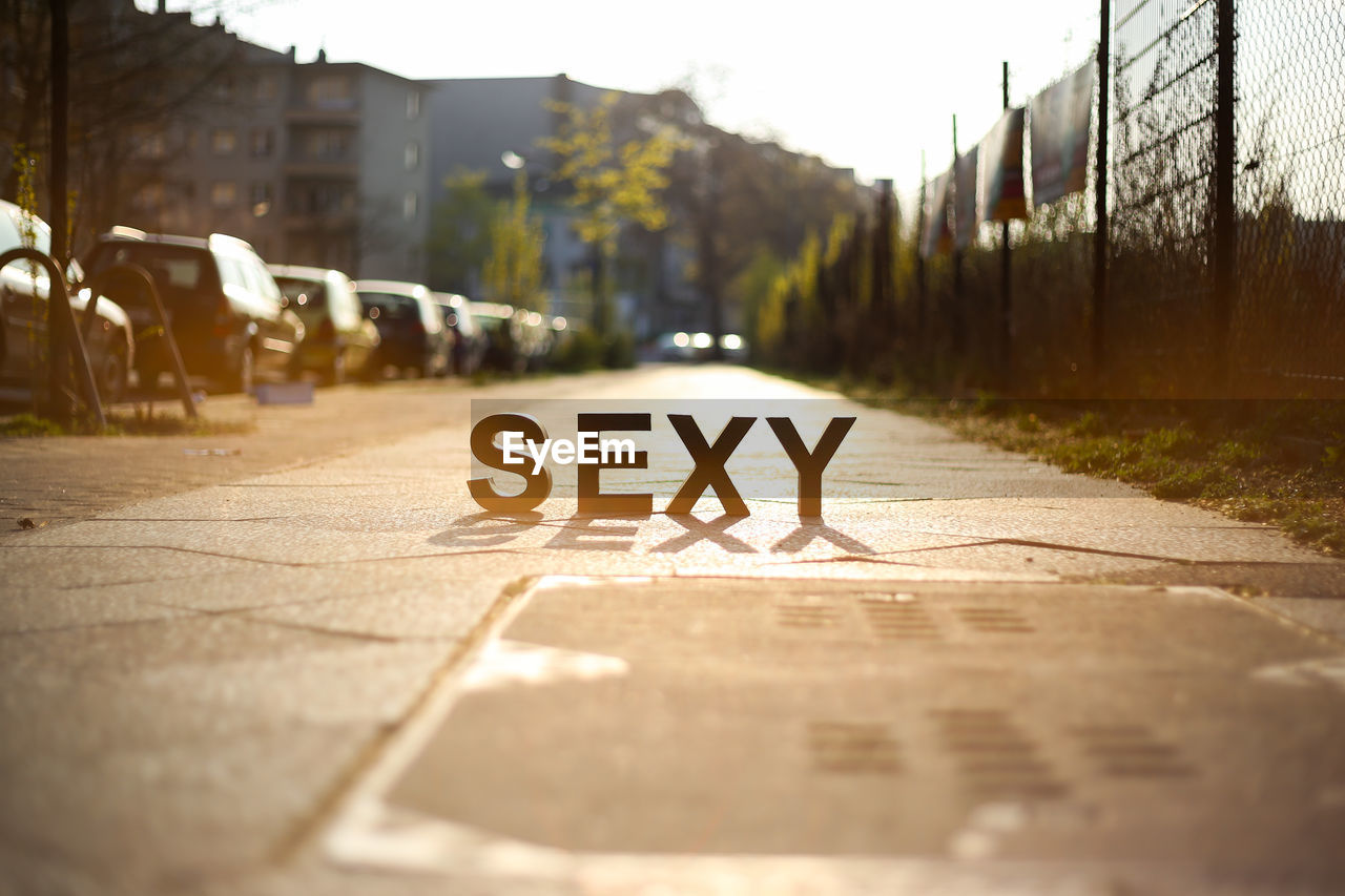 Sexy Text On Road During Sunny Day