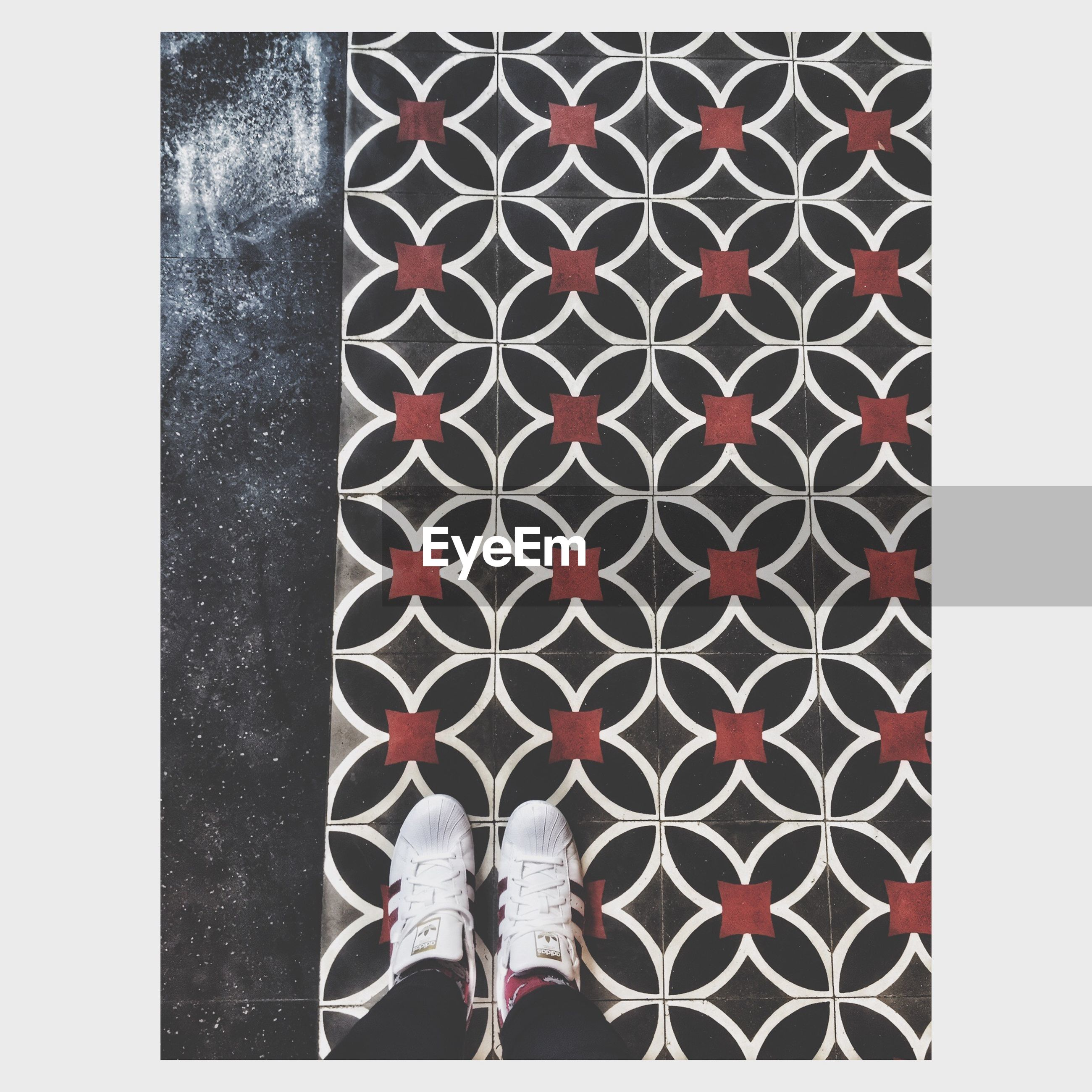 transfer print, auto post production filter, lifestyles, standing, men, low section, leisure activity, person, unrecognizable person, walking, pattern, street, casual clothing, outdoors, shoe, day