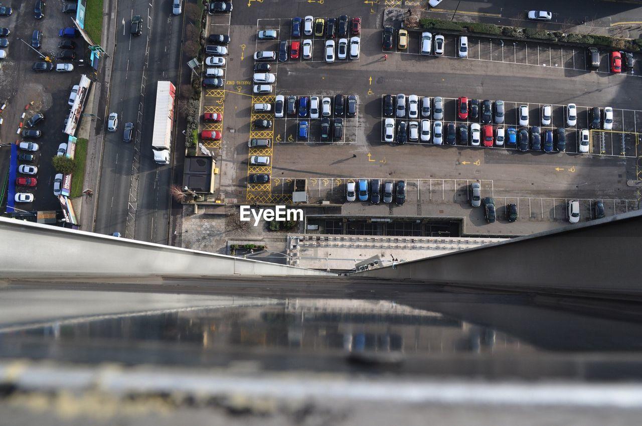 Tilt-shift image of cars at parking lot