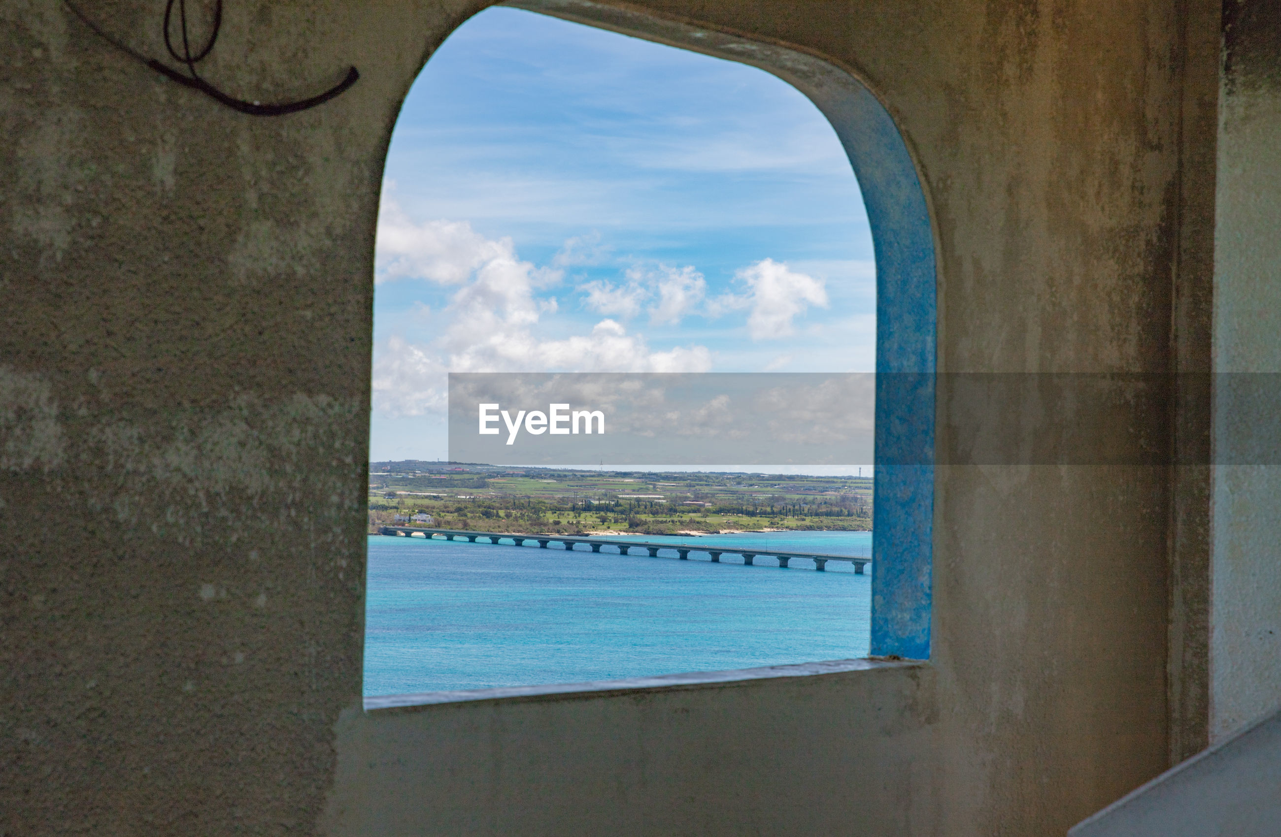 VIEW OF SEA AGAINST SKY SEEN THROUGH WINDOW