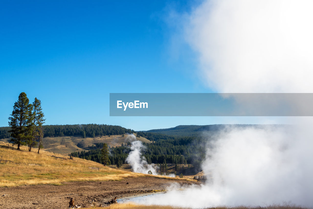 View of hot spring against blue sky