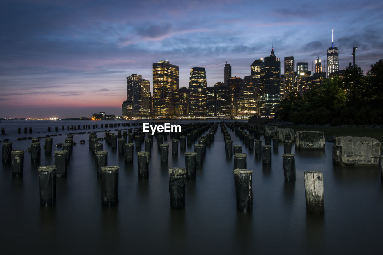 PANORAMIC VIEW OF BUILDINGS AGAINST SKY AT SUNSET