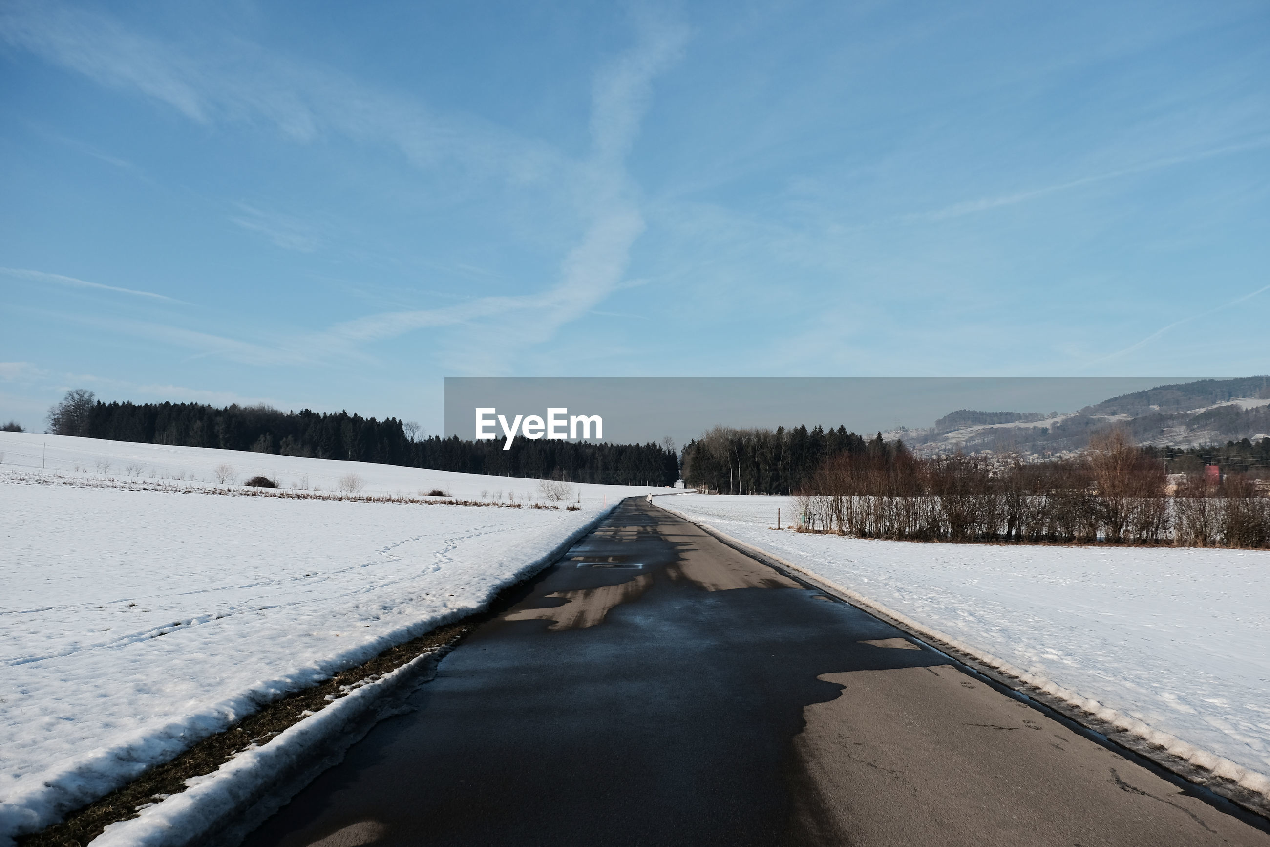 SCENIC VIEW OF WINTER AGAINST SKY