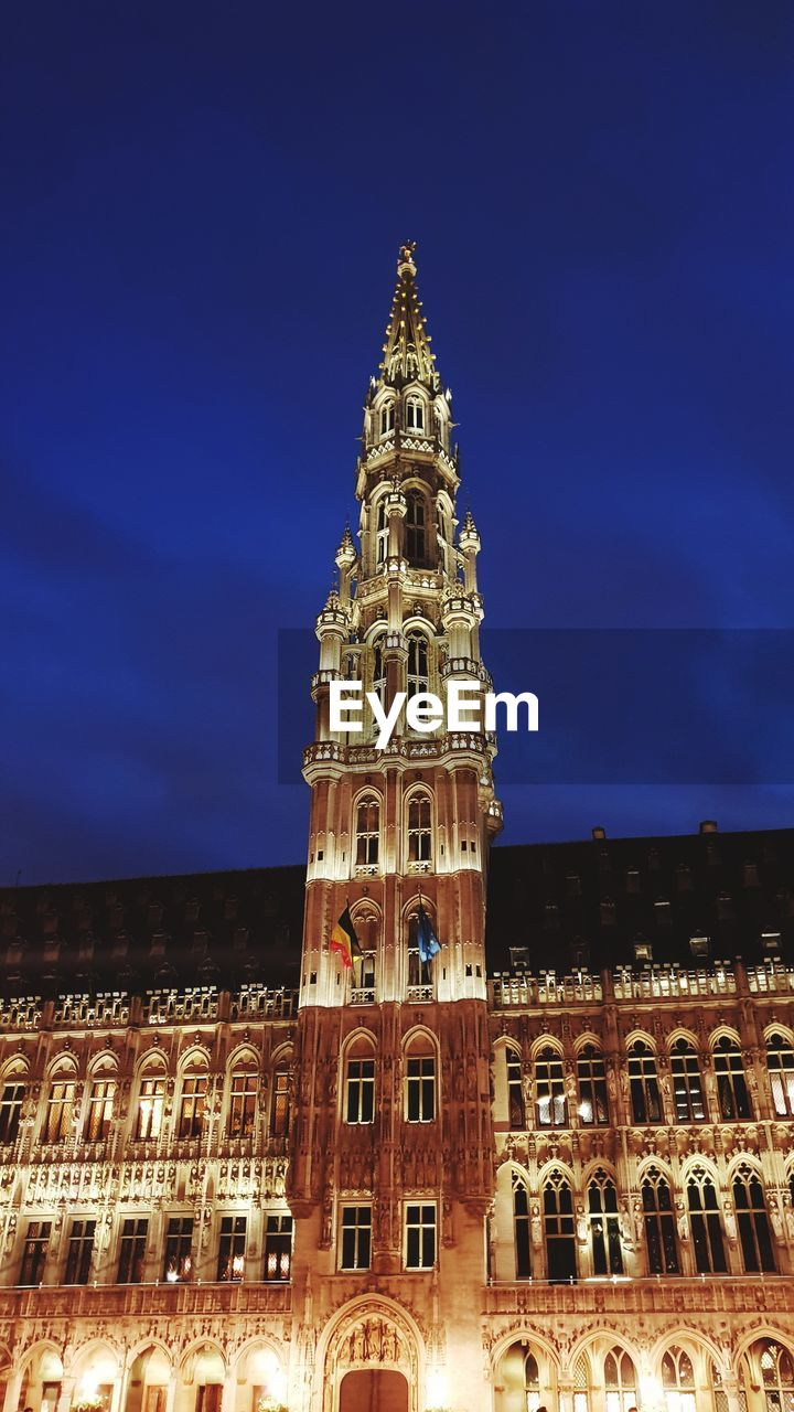 building exterior, built structure, architecture, sky, building, low angle view, travel destinations, no people, travel, city, tourism, tower, blue, night, illuminated, nature, tall - high, the past, history, outdoors, spire, gothic style