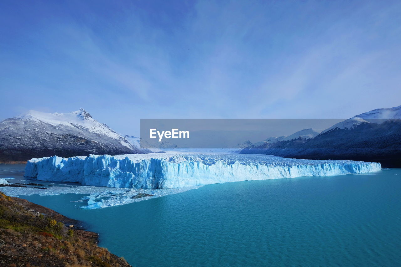water, scenics - nature, sky, glacier, beauty in nature, tranquil scene, tranquility, blue, cold temperature, environment, mountain, ice, no people, nature, winter, day, idyllic, landscape, waterfront, iceberg, snowcapped mountain, turquoise colored, melting