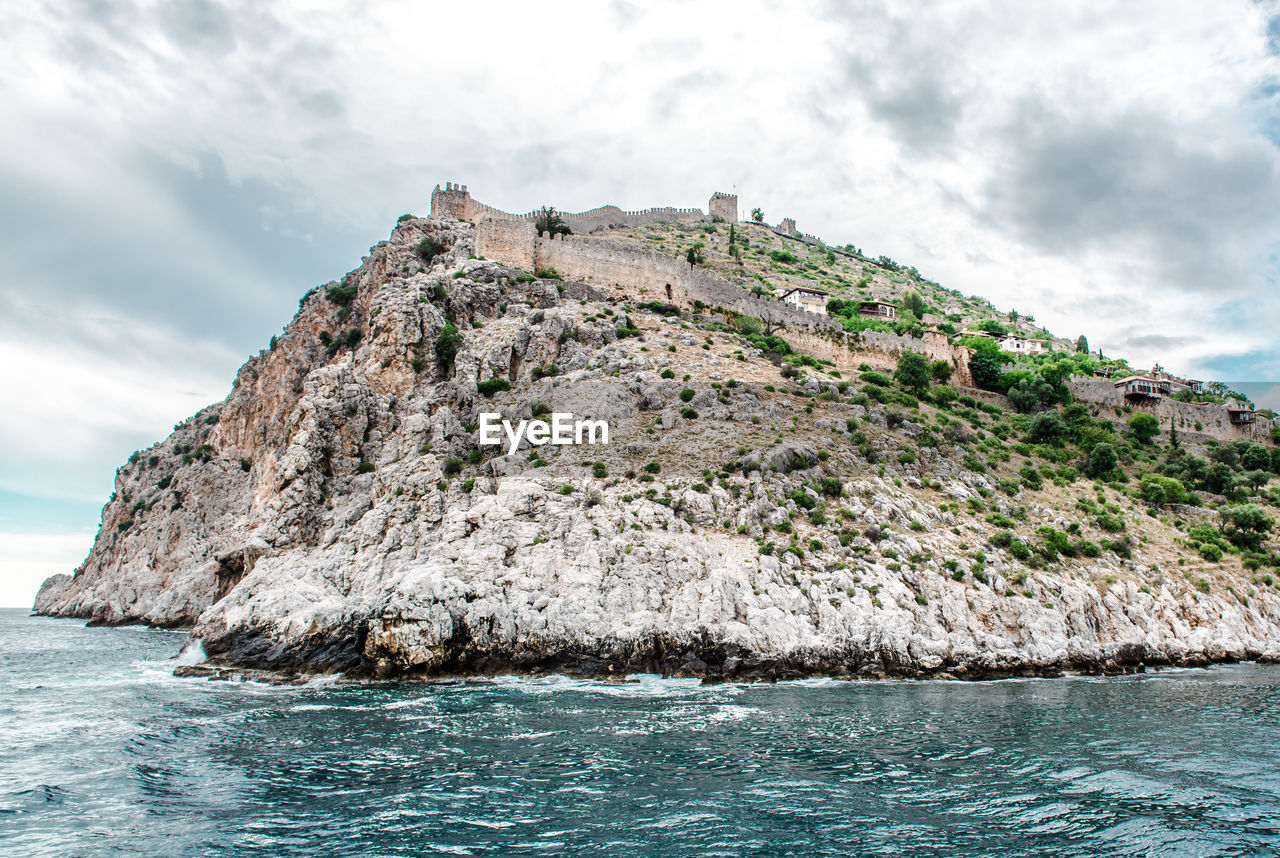 Fortress On Mountain By Mediterranean Sea Against Sky