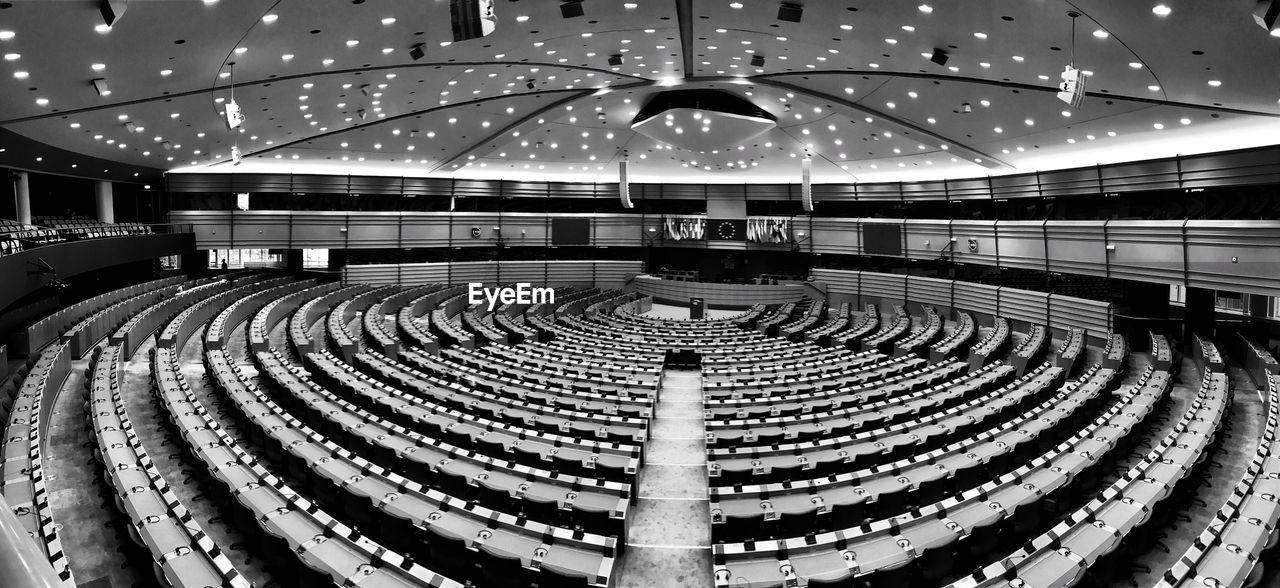 architecture, indoors, built structure, auditorium, stadium, illuminated, seat, no people, film industry, day