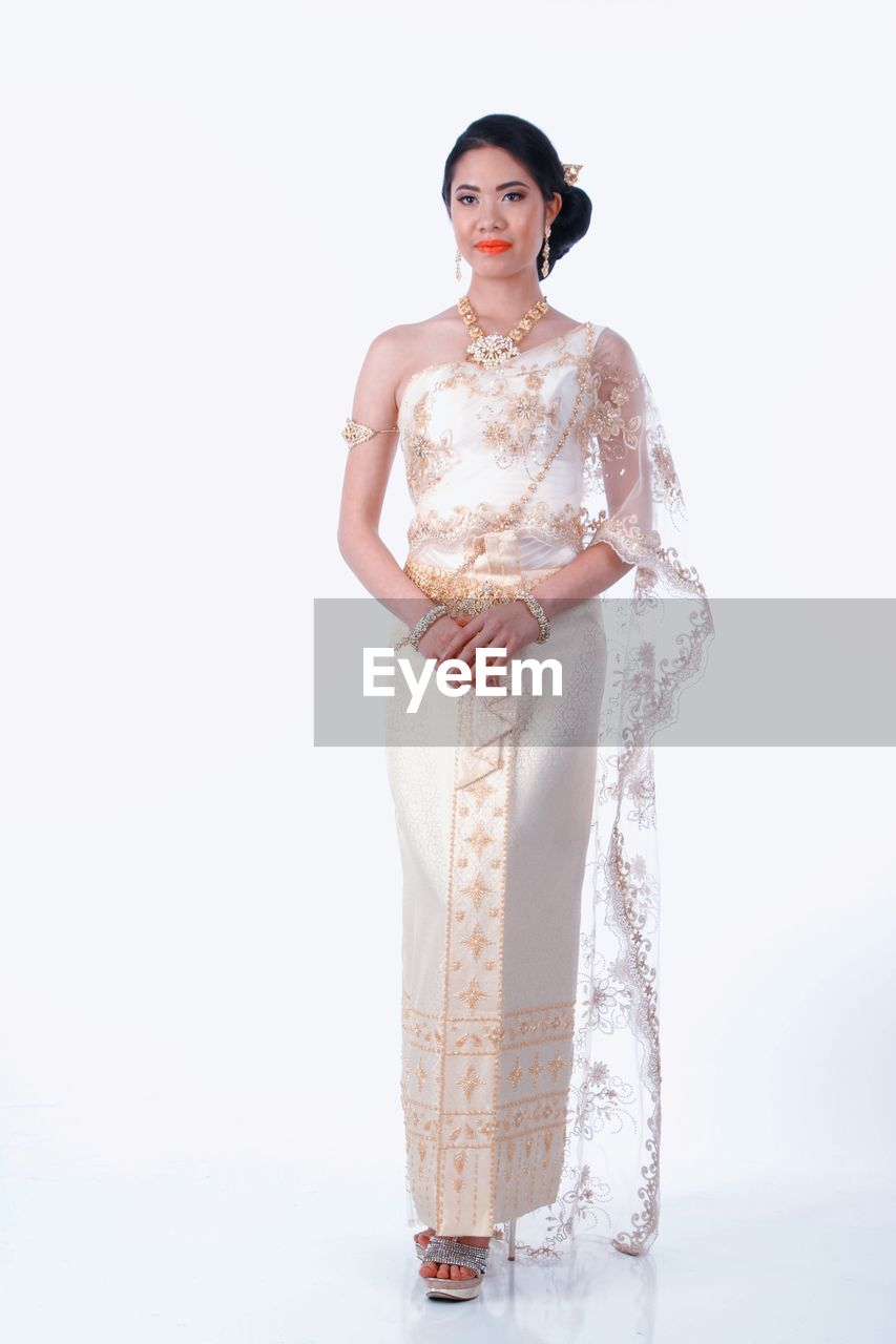 studio shot, white background, celebration, beautiful woman, full length, standing, fashion, traditional clothing, young adult, young women, one person, sari, looking at camera, wedding dress, bride, glamour, portrait, fashion model, indoors, people