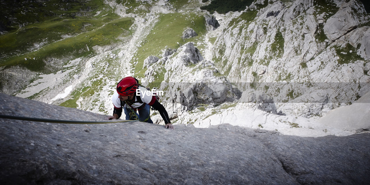 two people, adventure, rock - object, full length, motion, risk, togetherness, only men, journey, day, adults only, leisure activity, climbing, challenge, outdoors, headwear, rock climbing, adult, sports helmet, people, young adult, nature, friendship, extreme sports, teamwork