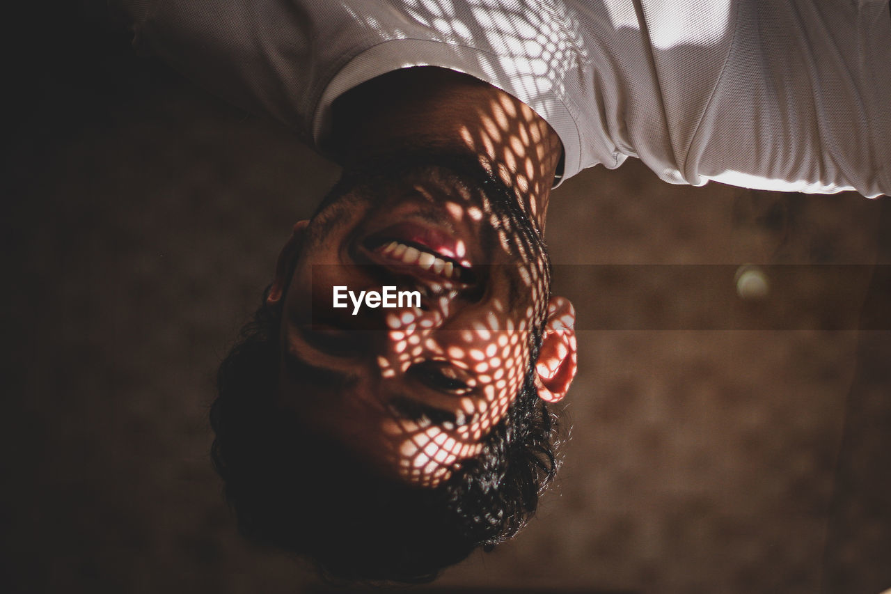 Upside down portrait of smiling man