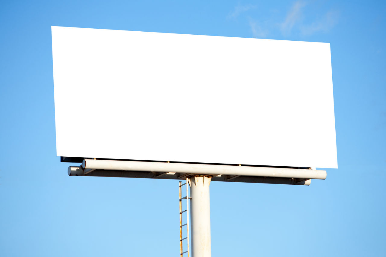 blank, copy space, sky, clear sky, blue, no people, low angle view, white color, day, nature, outdoors, billboard, advertisement, geometric shape, sign, communication, shape, placard, design, lighting equipment