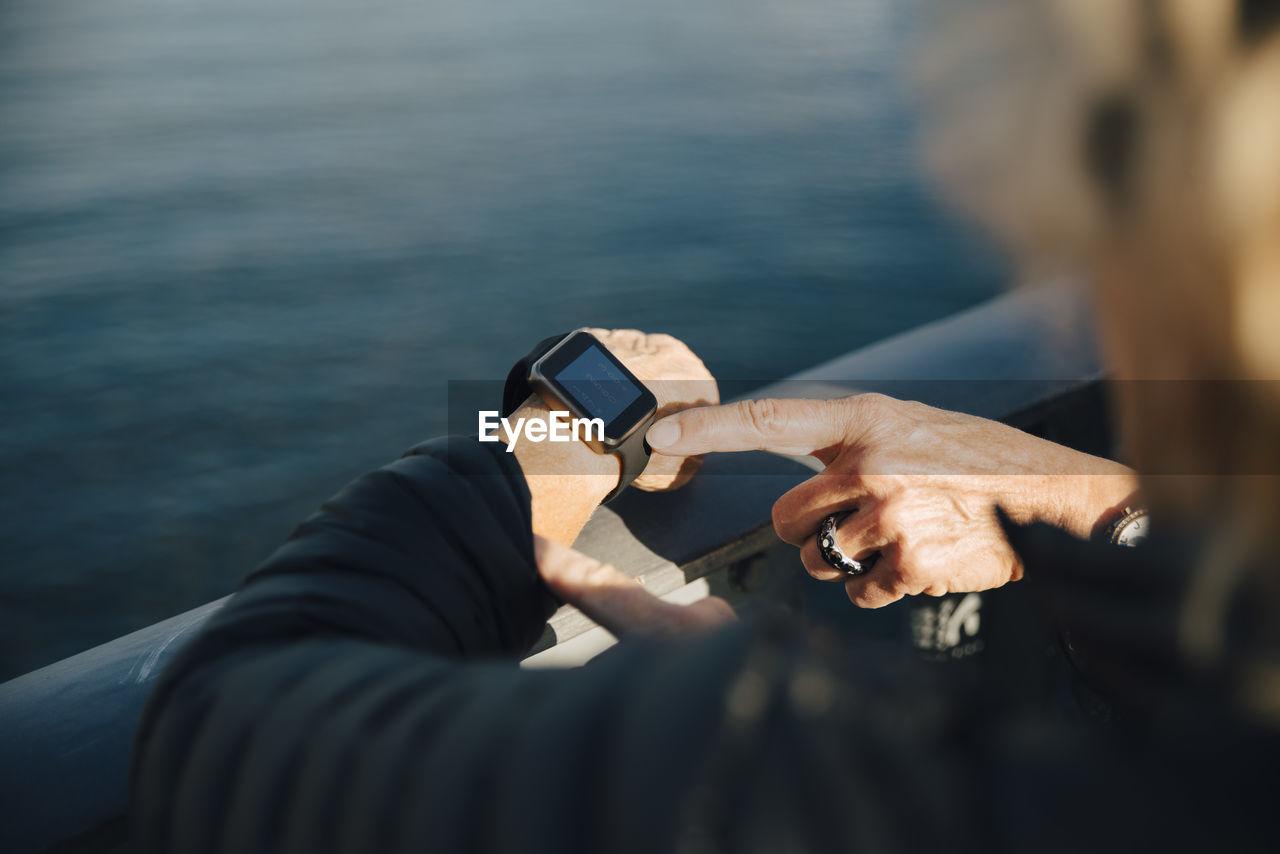MAN USING MOBILE PHONE IN WATER