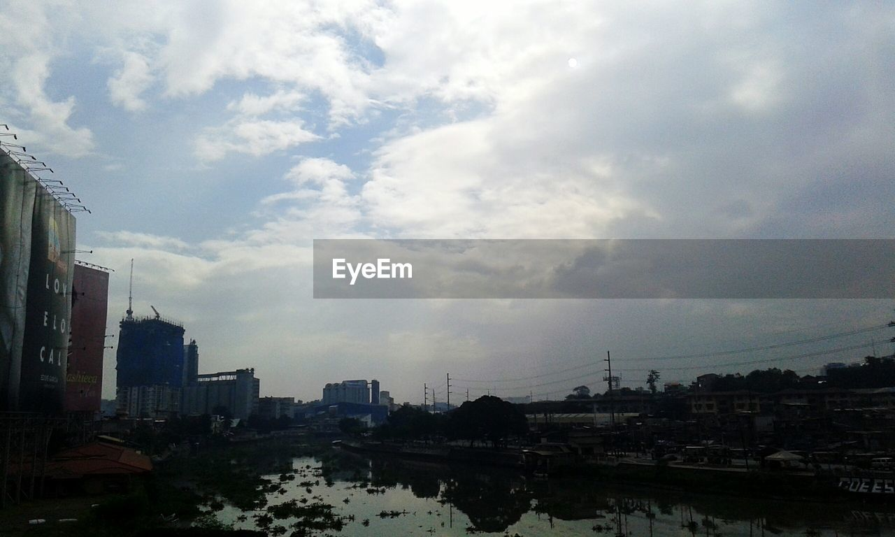 city, architecture, building exterior, cityscape, built structure, sky, cloud - sky, skyscraper, city life, outdoors, no people, travel destinations, day, modern, urban skyline