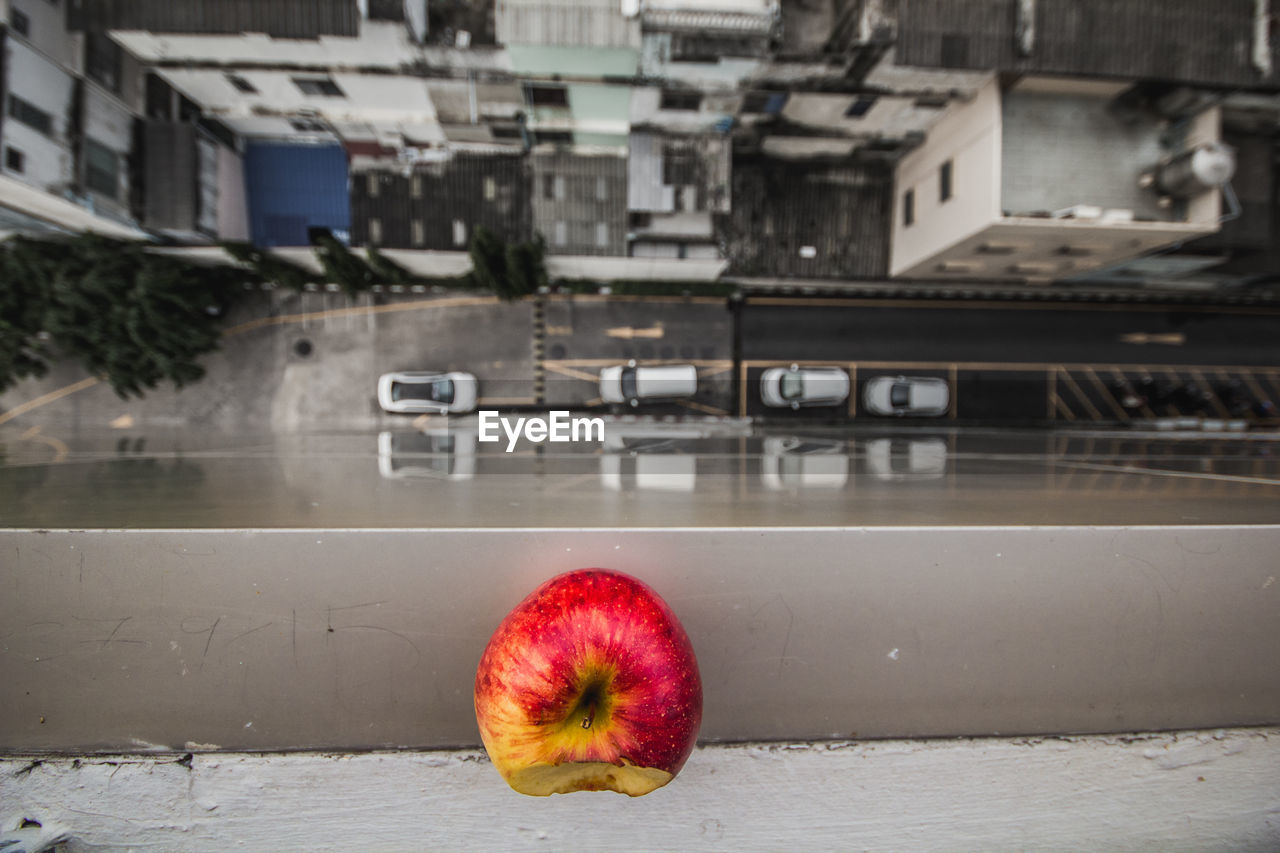 Close-up of apple on building terrace